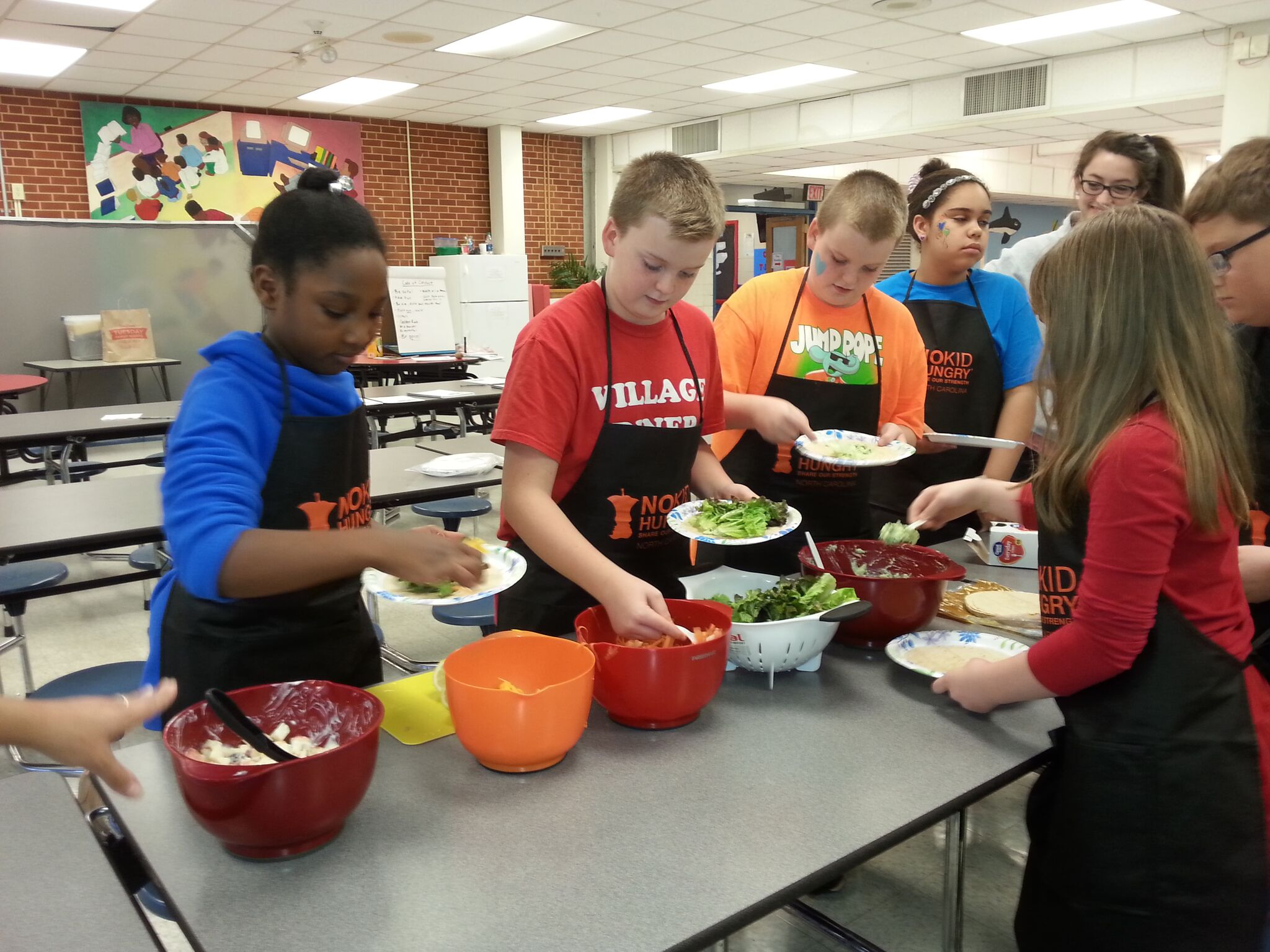 Students preparing a Cooking Matters for Kids recipe